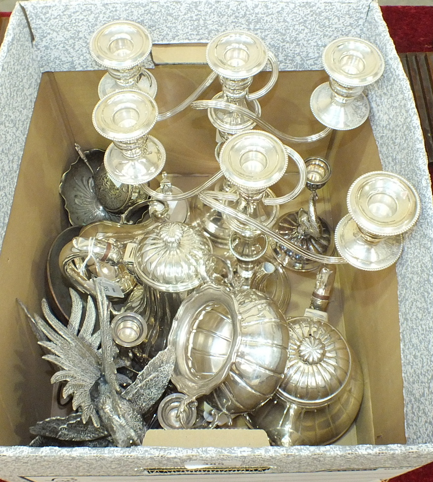 A four-piece melon shape plated tea service, a pair of three-branch candelabra and other plated