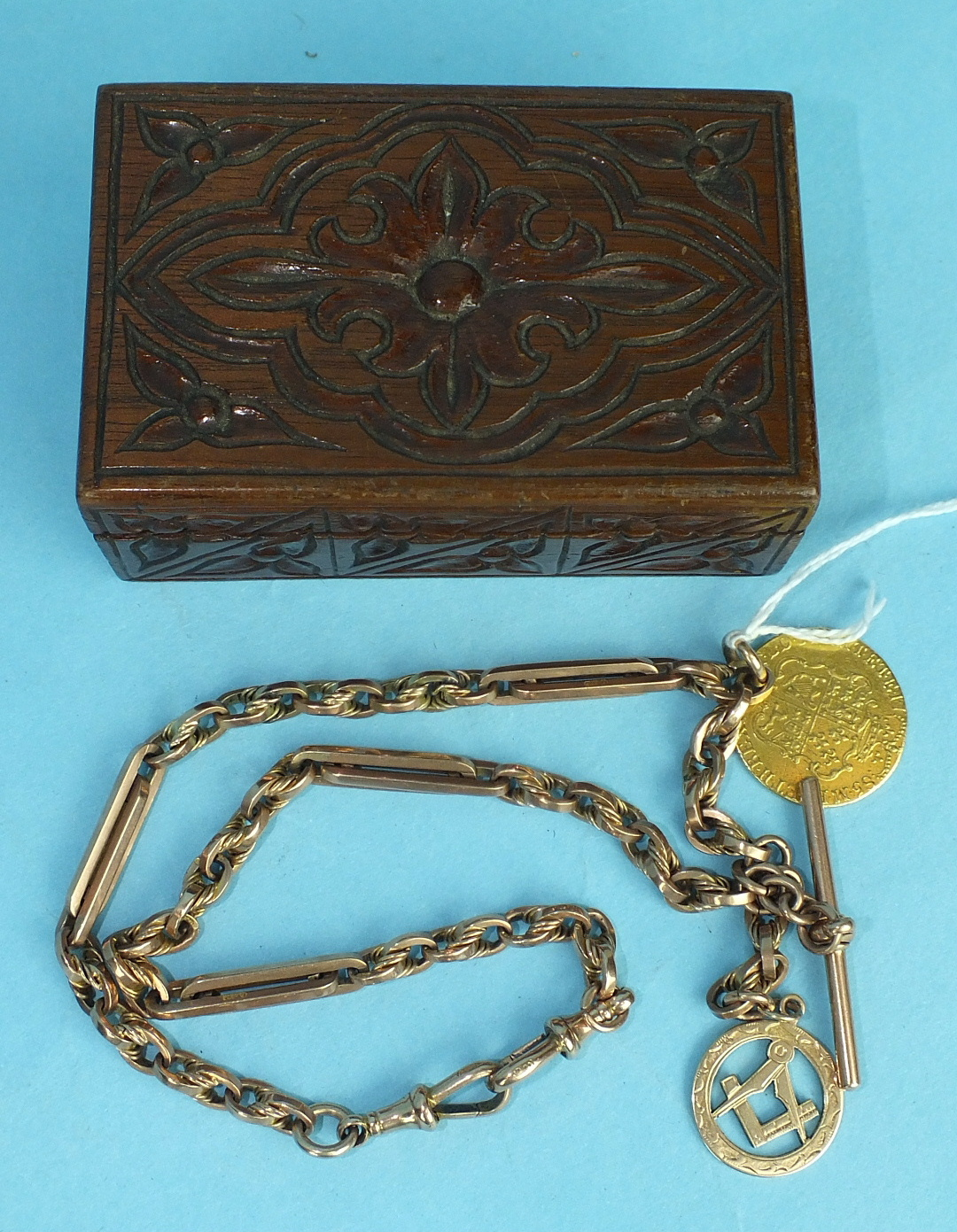 Lot 203 - A 9ct rose gold Albert watch chain with Masonic fob and 1785 guinea, (holed), total weight 58g, in