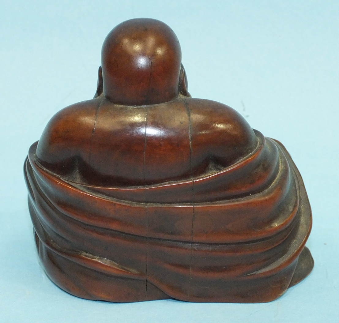 A large 19th century Chinese carved wood figure of a portly Poutai, seated and with a bat on his - Image 5 of 6
