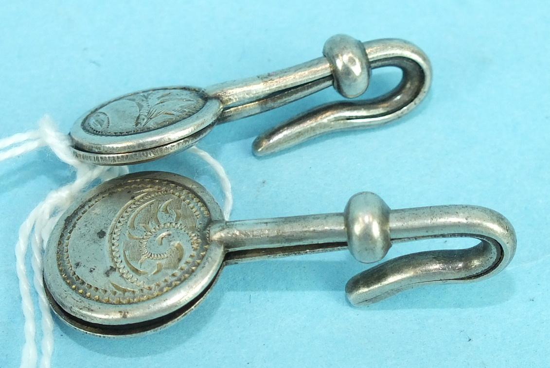 Lot 413 - Two silver napkin hooks by Adie & Lovekin Ltd, Birmingham 1913/14, (2).