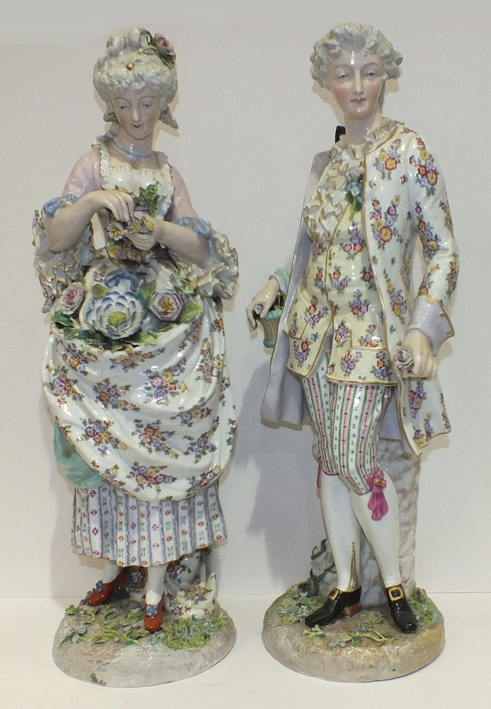 A large pair of 19th century Continental Meissen-style porcelain figures of a gallant and his