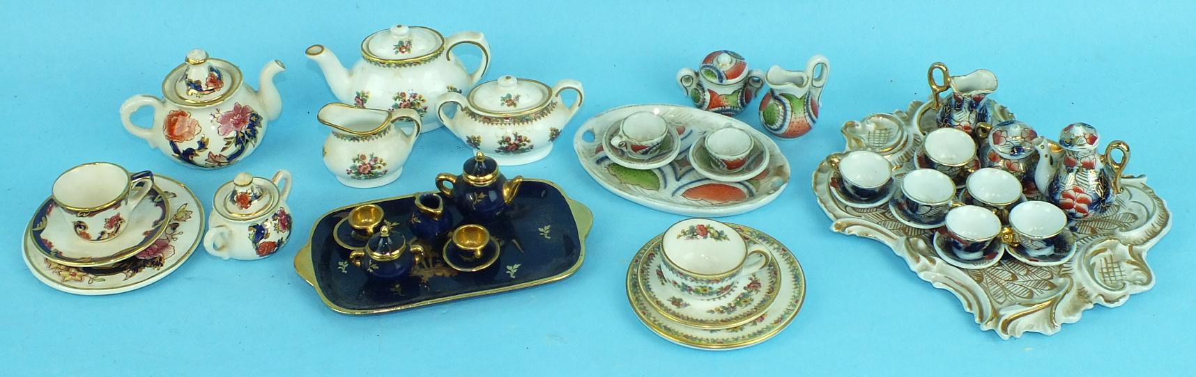 A Coalport 'Ming Rose' decorated miniature tea set for one, a similar Mason's Mandalay tea set, (