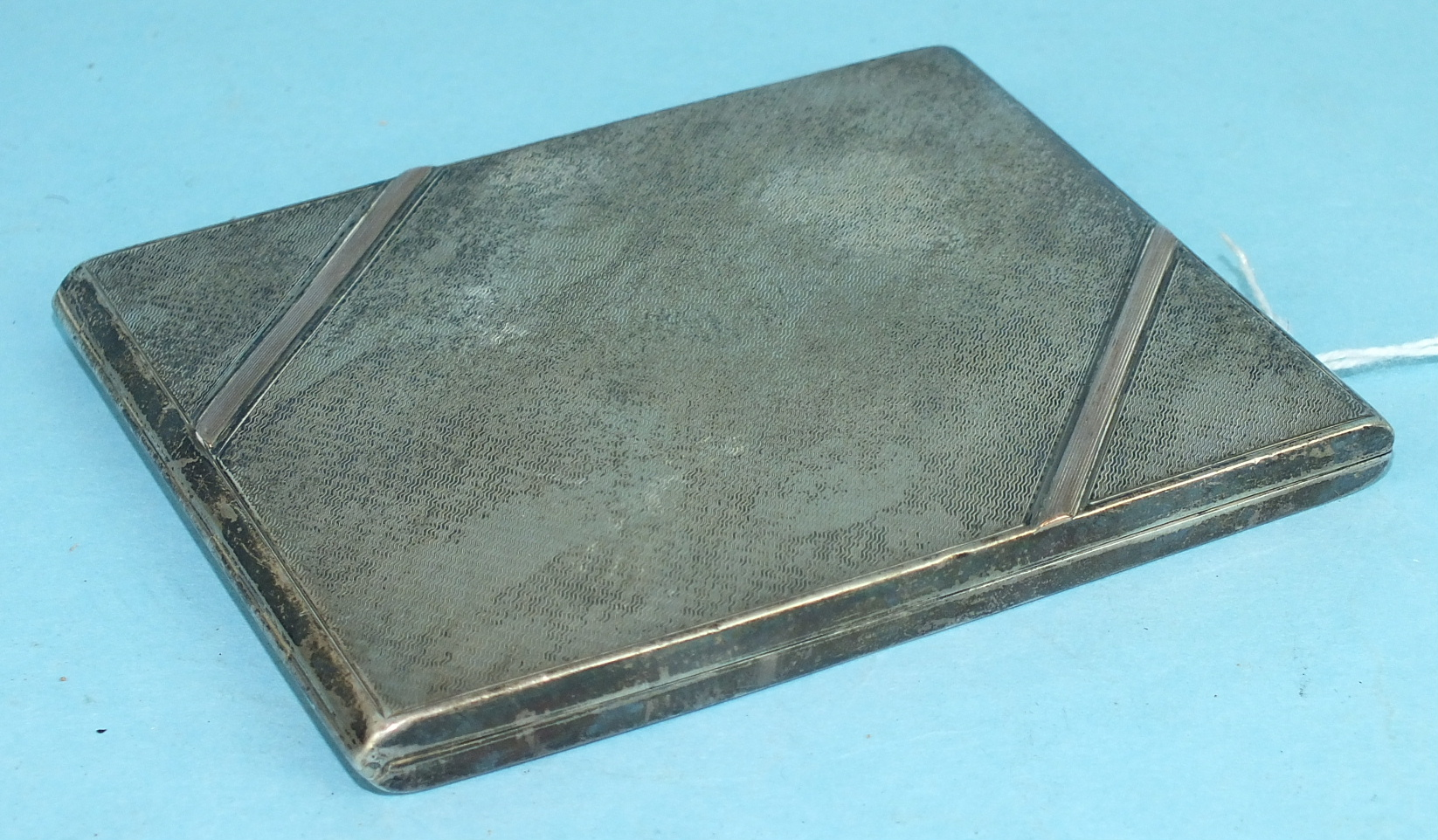 Lot 430 - A silver engine-turned cigarette case, Birmingham 1930, 10.5 x 8.2cm, ___3½oz, (inscribed to