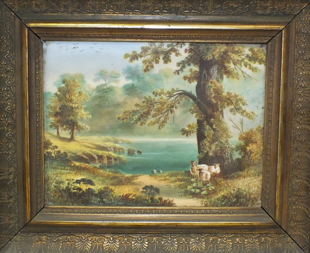 A Continental ceramic plaque depicting sheep in a lakeland scene, 16 x 22cm.