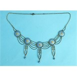 An early-20th century 925 silver necklace of five blue and white enamelled bosses, with filigree