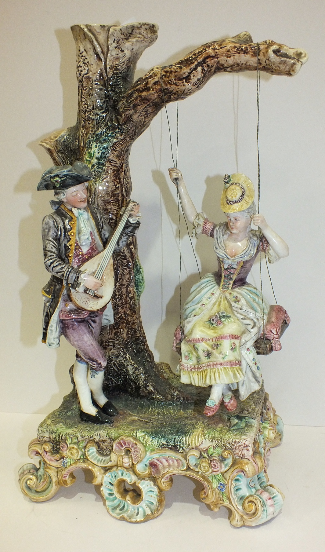 A large 19th century Royal Dux Bohemia porcelain group of a gallant playing a lute to his