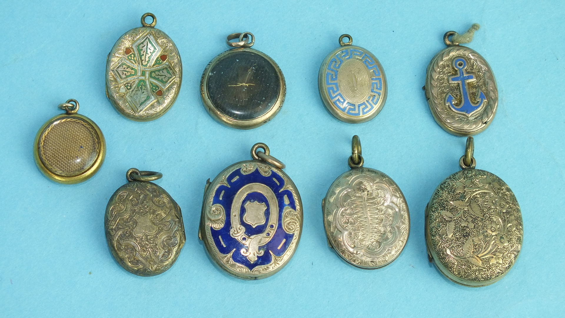 Lot 235 - A collection of nine enamelled and engraved lockets, (9).