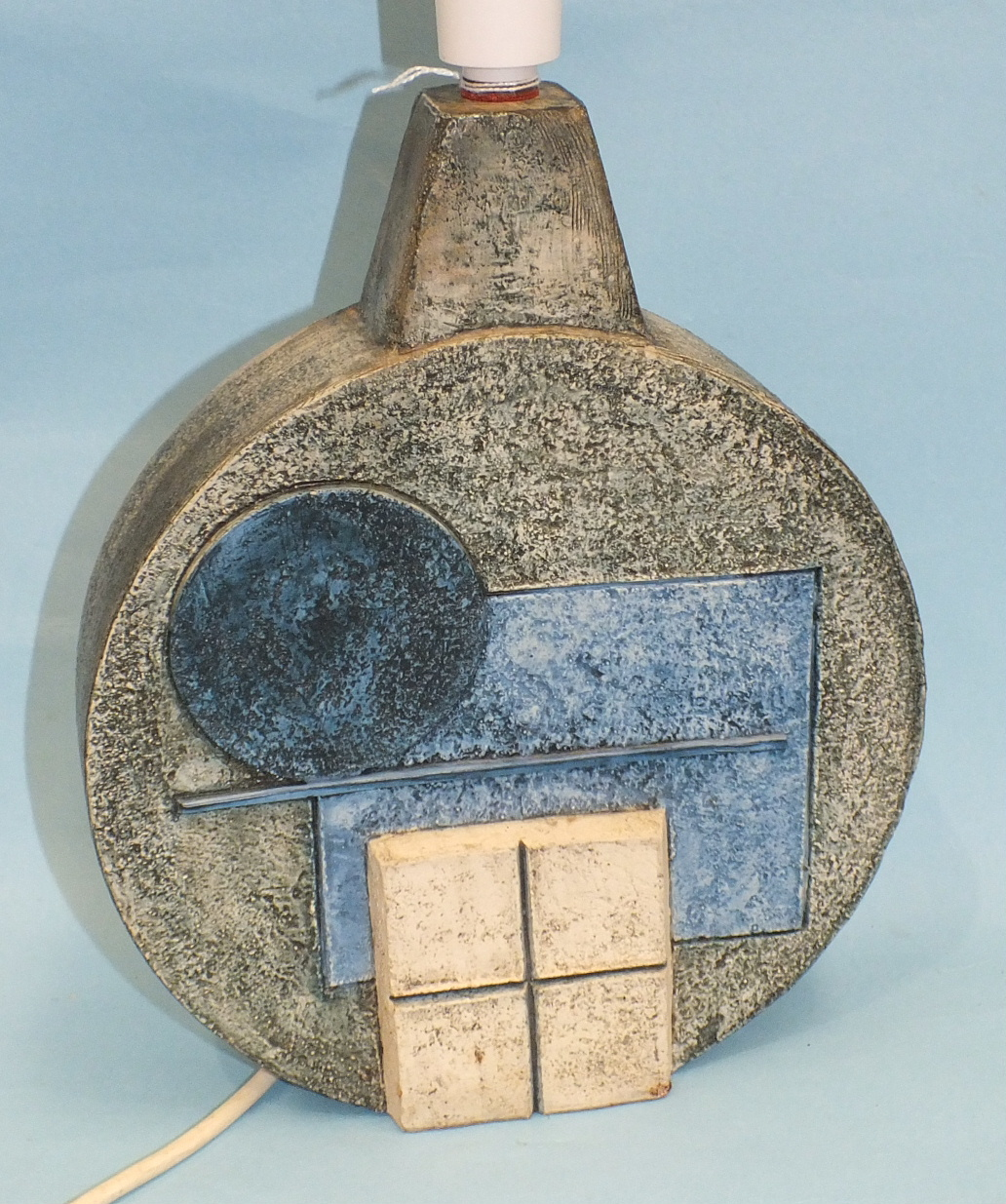 A Troika Pottery wheel table lamp decorated in relief with geometric patterns, 27cm high, factory