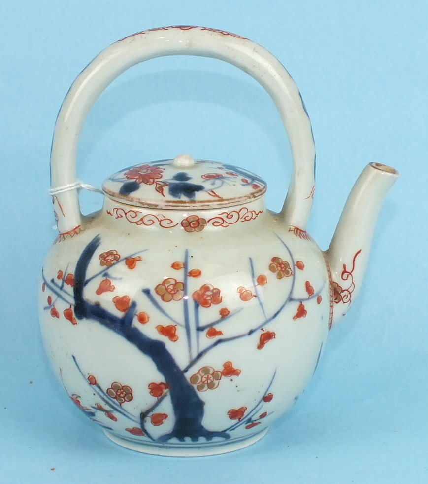 An 18th century Japanese Arita porcelain teapot and cover with loop handle, decorated in Imari