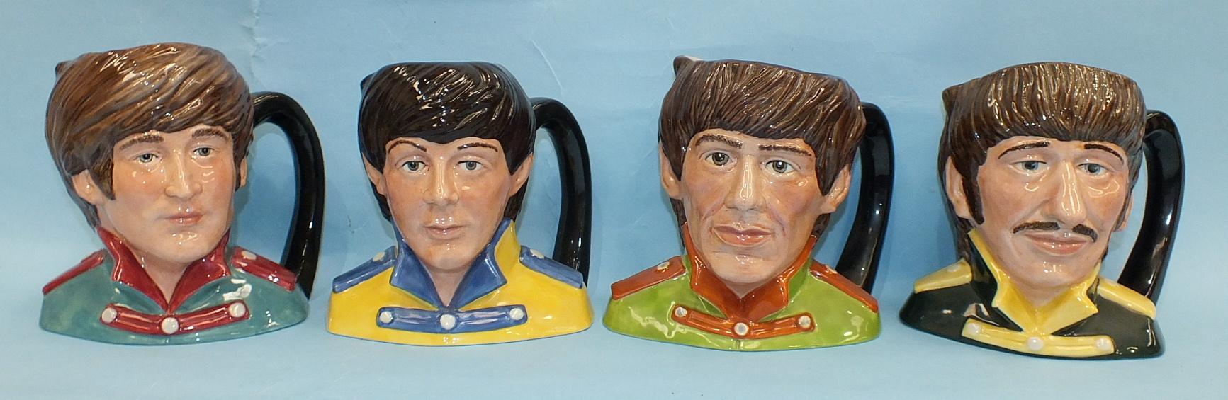 A set of four Royal Doulton 'The Beatles' character jugs, 'Paul McCartney' D6724, 'John Lennon'