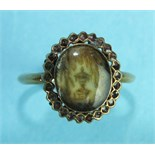 A George III mourning ring with oval ivory glazed panel depicting an urn below a weeping willow,