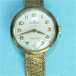 Rolex, a ladies 9ct gold Precision wrist watch, the round face with Arabic numerals, on integral