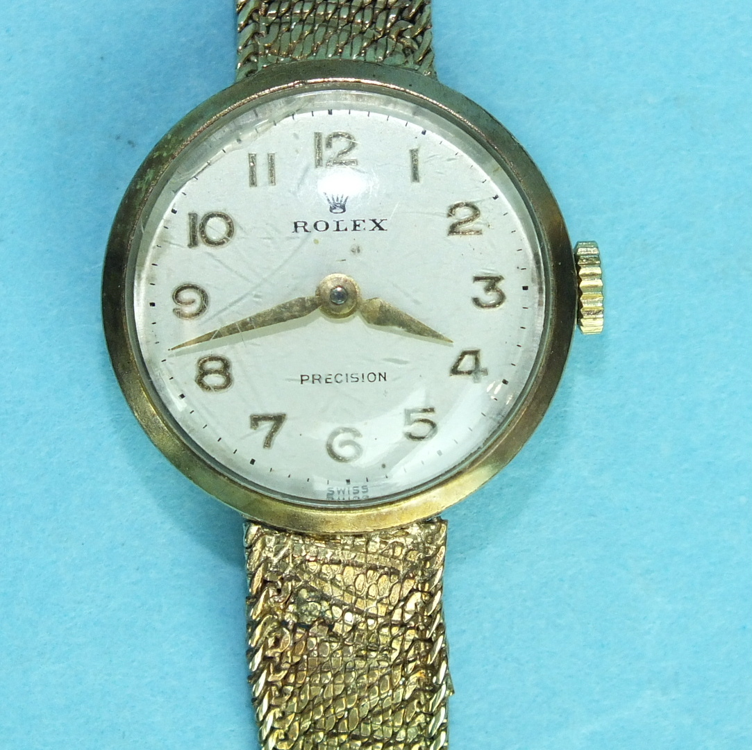 Lot 152 - Rolex, a ladies 9ct gold Precision wrist watch, the round face with Arabic numerals, on integral