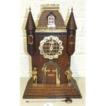 A late-19th century Continental mantel clock in the form of a French chateau, with gilt metal