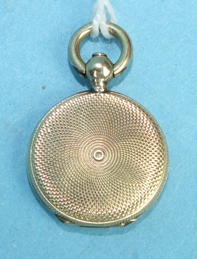Lot 289 - A small Edwardian locket with engine-turned engraving.