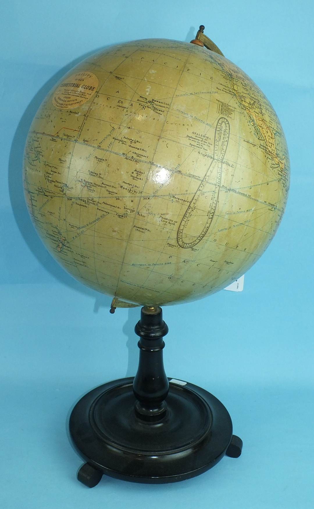 """A Philips' 12"""" Terrestrial Globe on stand, no.2615, showing 'Principal Steamship Routes with"""