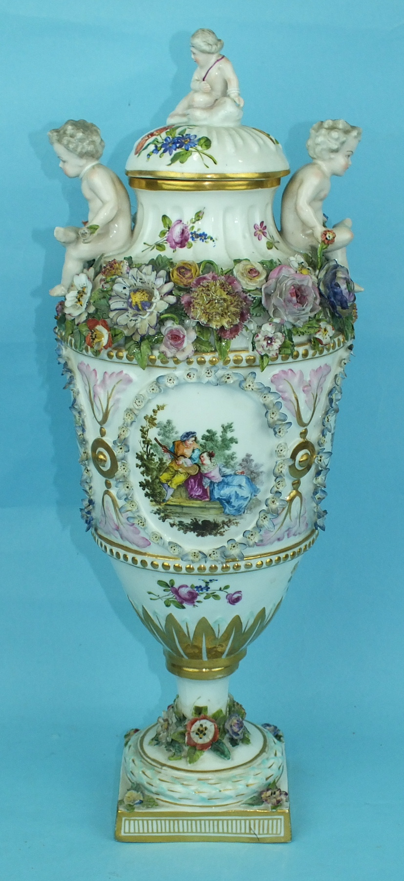 A large 19th century Continental porcelain vase and cover painted with an oval panel of a courting