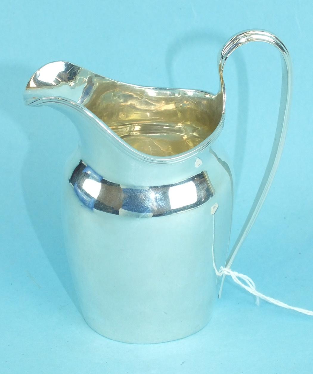 Lot 446 - A silver cream jug, 12.5cm high, Chester 1913, engraved initials, ___3½oz.