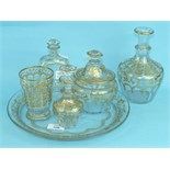 A 19th century Continental gilded glass tray together with various matching bottles and jars, (6