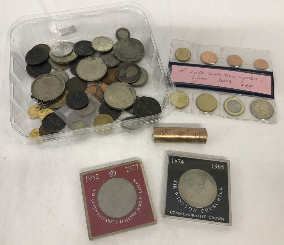 Lot 96 - A tin of assorted coins to include commemorative crowns and set of 1st Euro coins from Cyprus, 2008.