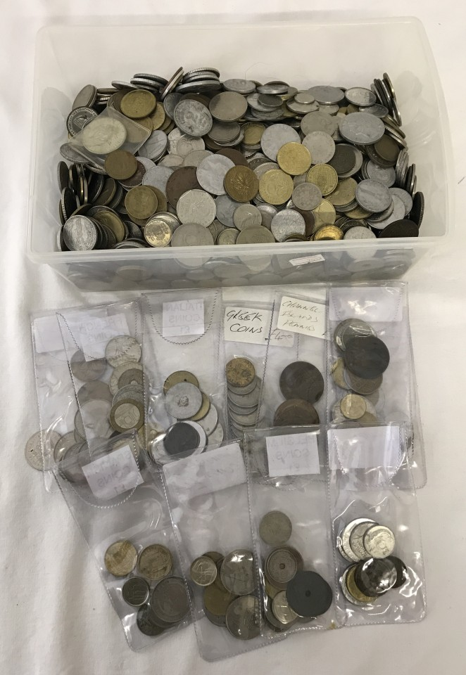 Lot 45 - A tub of assorted foreign coins.