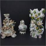 Three Meissen style porcelain pieces, to include a figural candlestick with cherubs and encrusted