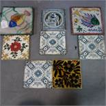 A collection of eight tiles, two include two large tiles decorated with fish, 20 x 20cm, a Minton'