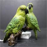 A cold painted bronze of two parrots on a branch, signed to reverse, H.10 W.10cm