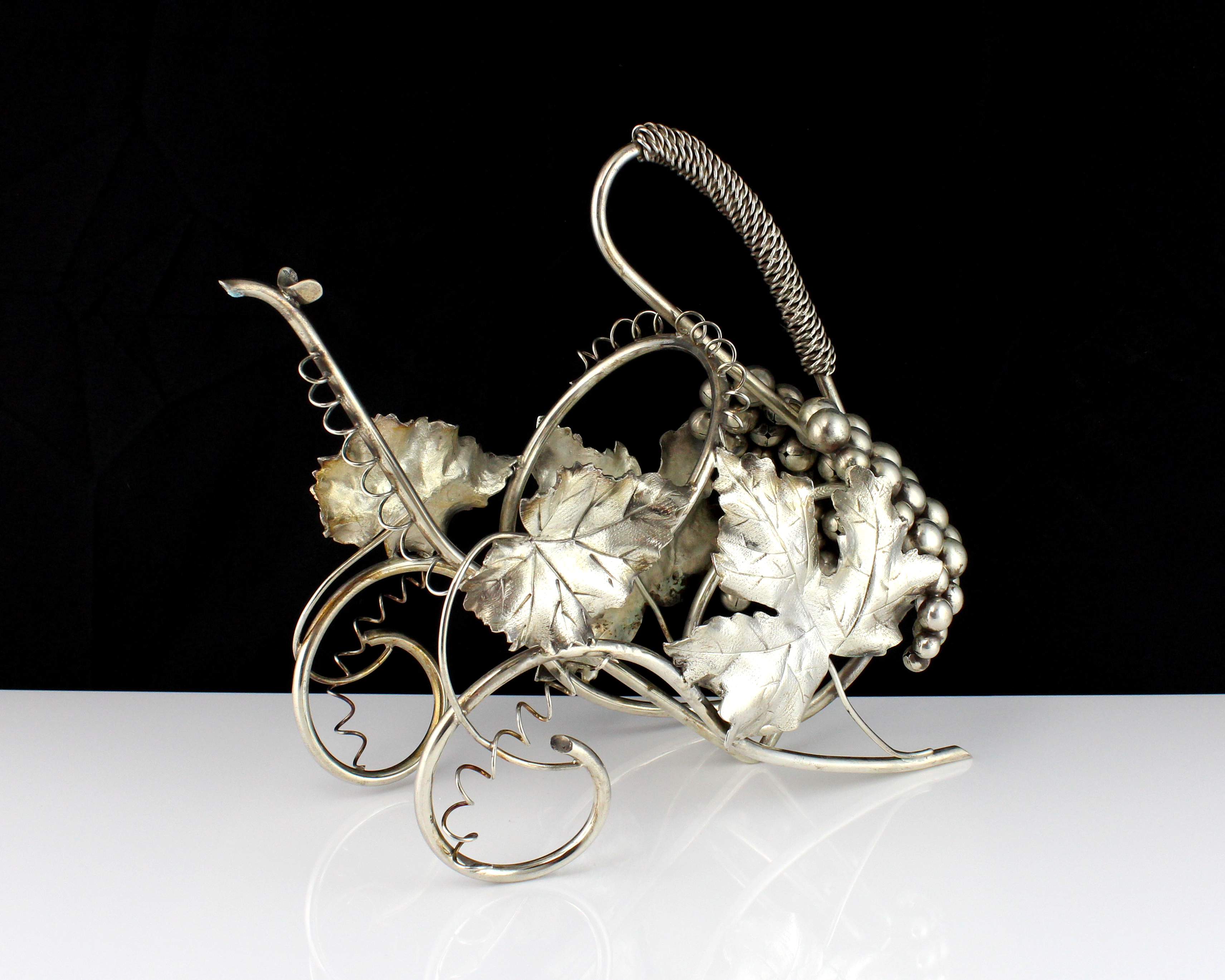 A vintage Italian 800 Silver wine bottle holder circa 1960. The wirework carriage body with
