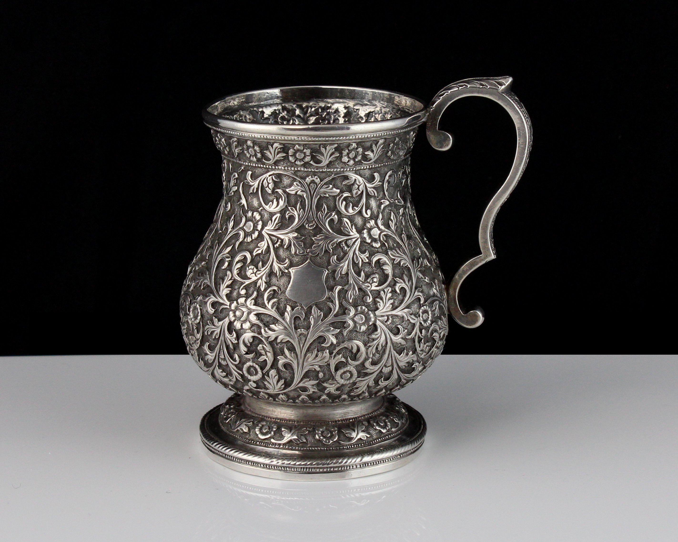 An antique Indian Silver cup / mug Kutch circa 1890 of baluster form on a spreading foot with