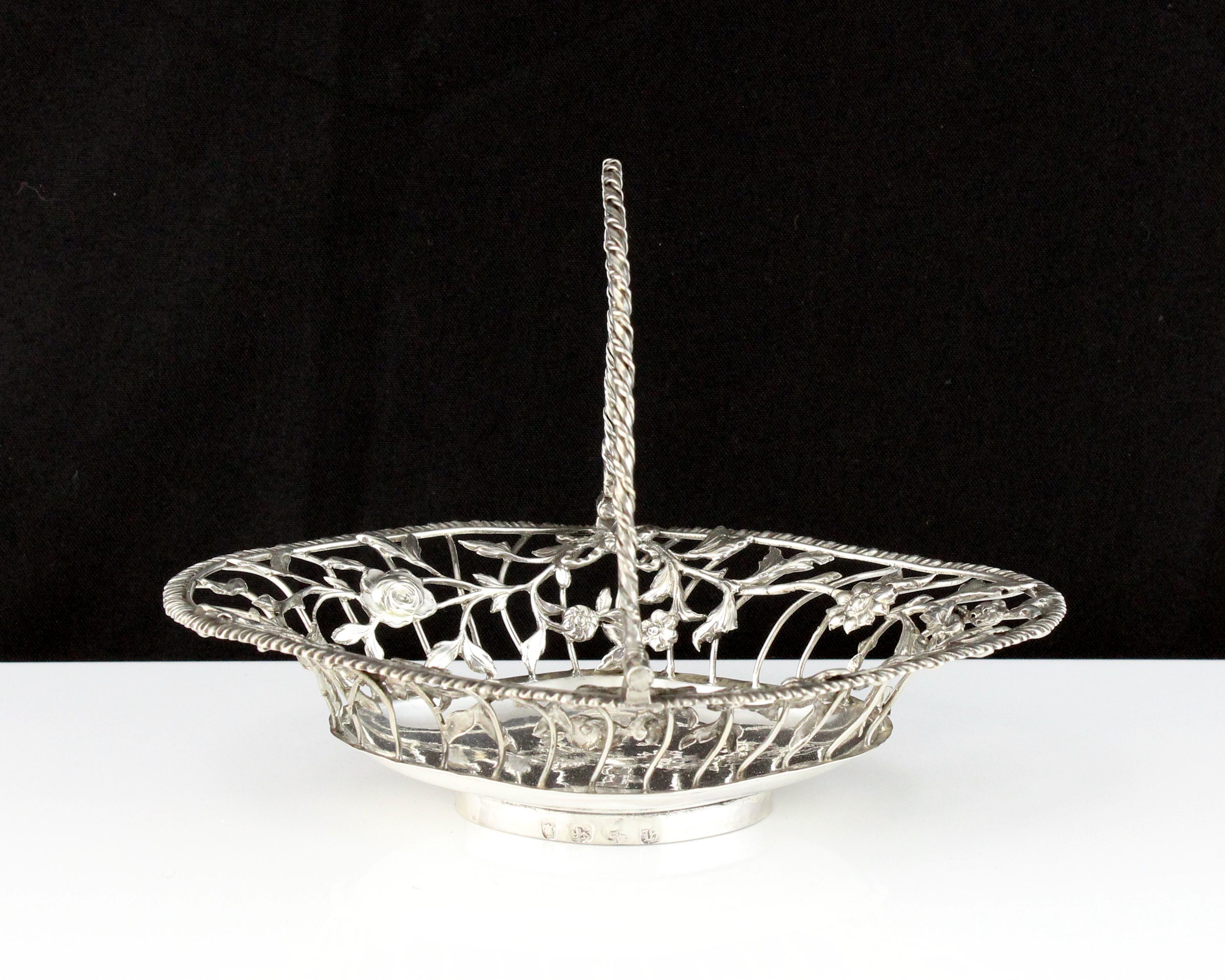 An antique George III Sterling Silver bon bon basket by Lutwyche & Vere, London, 1763 of navette