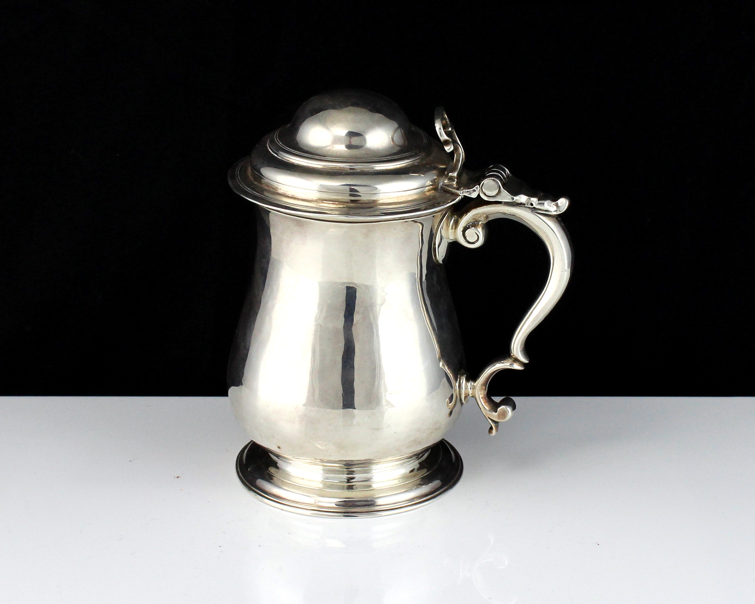 Los 56 - A rare antique George II Sterling Silver ladies lidded tankard by Fuller White, London 1750 of