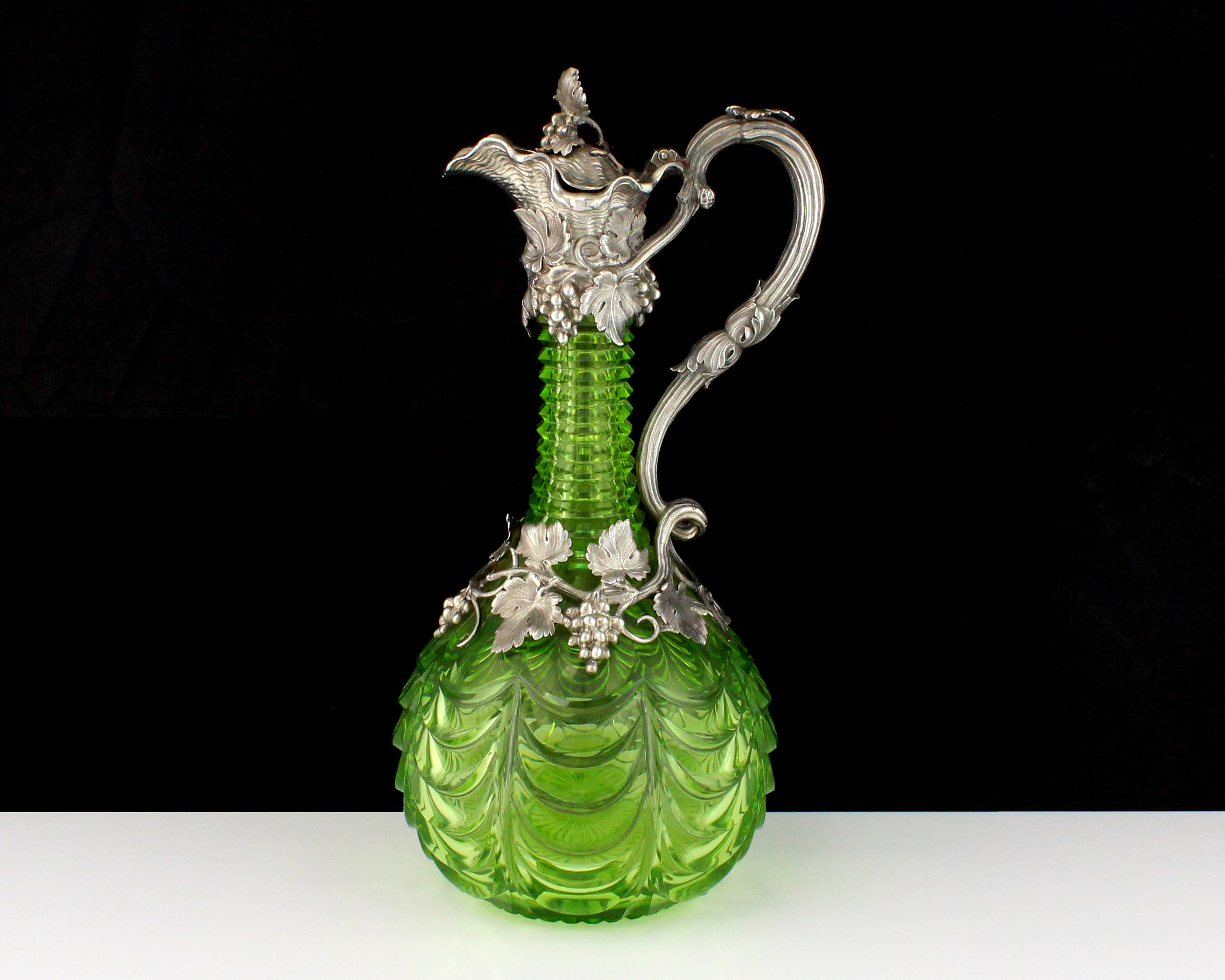 An antique Victorian Sterling Silver mounted claret jug by the Barnard Brothers, London 1839 the