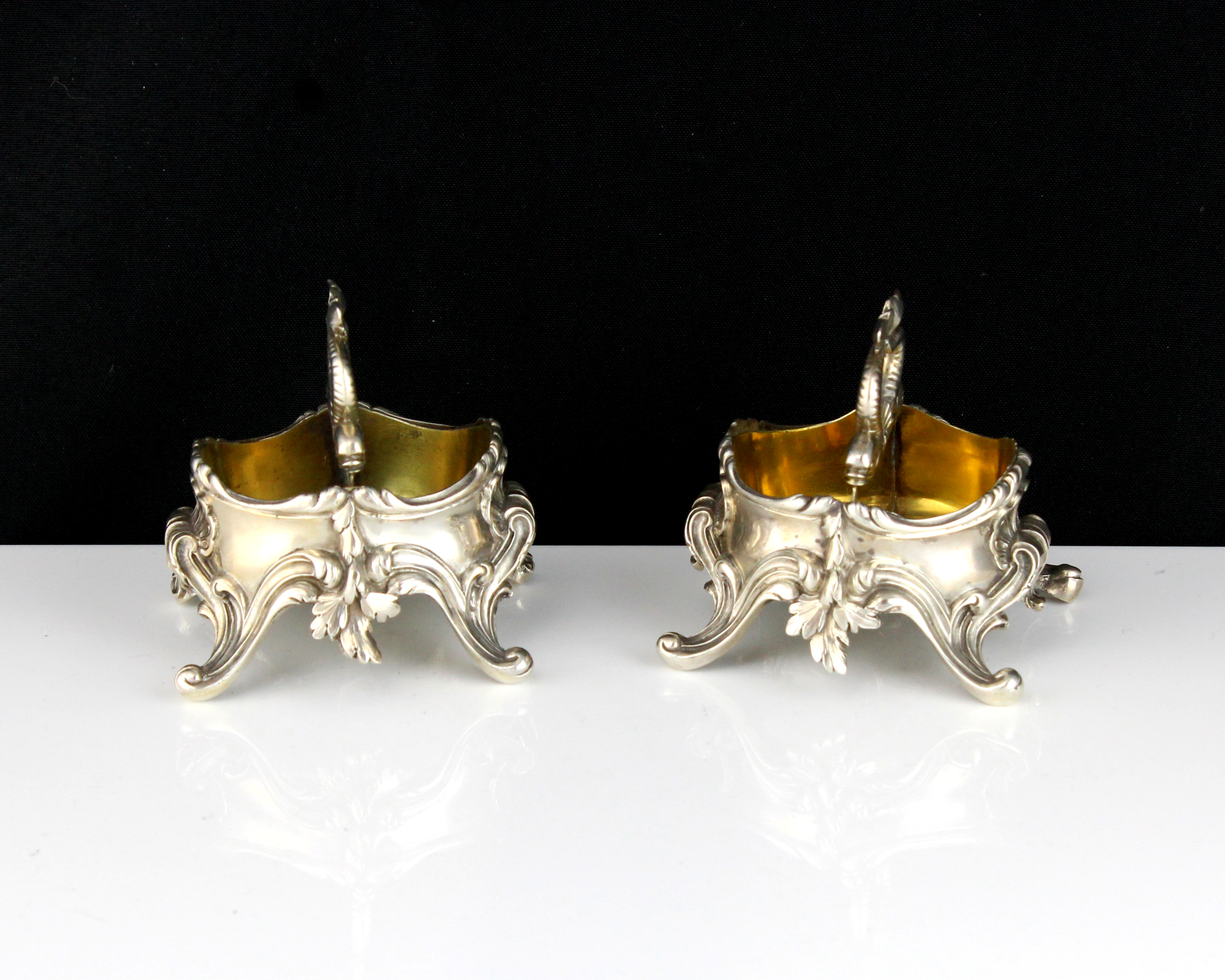 A pair of antique 19th Century French Silver salt / condiment cellars by Durand each of oval form on