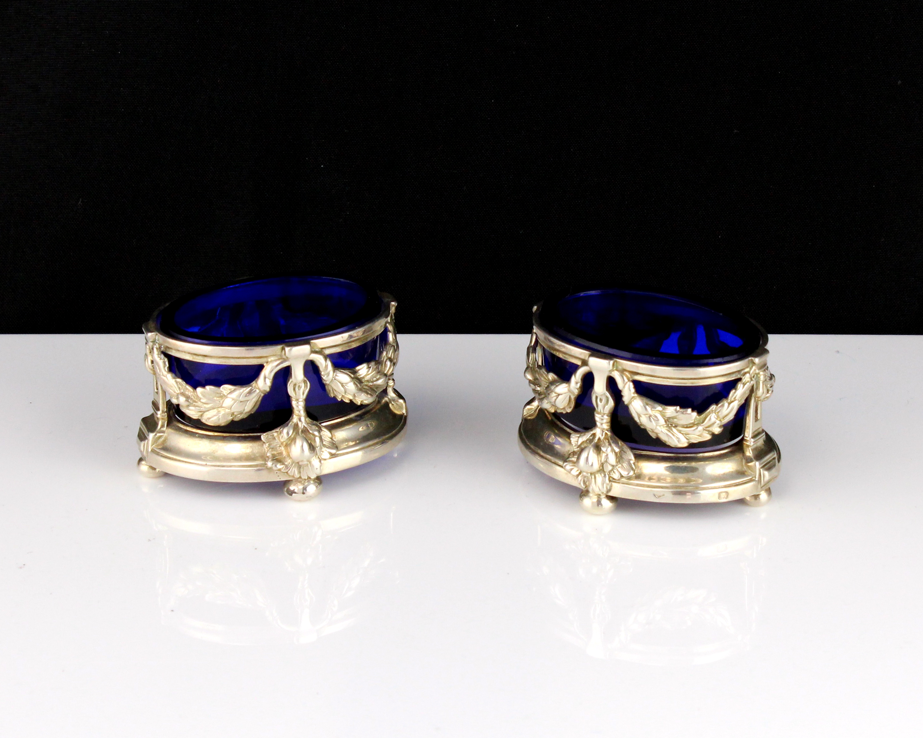 A pair of antique 19th Century French Silver salt cellars each of oval form, designed with