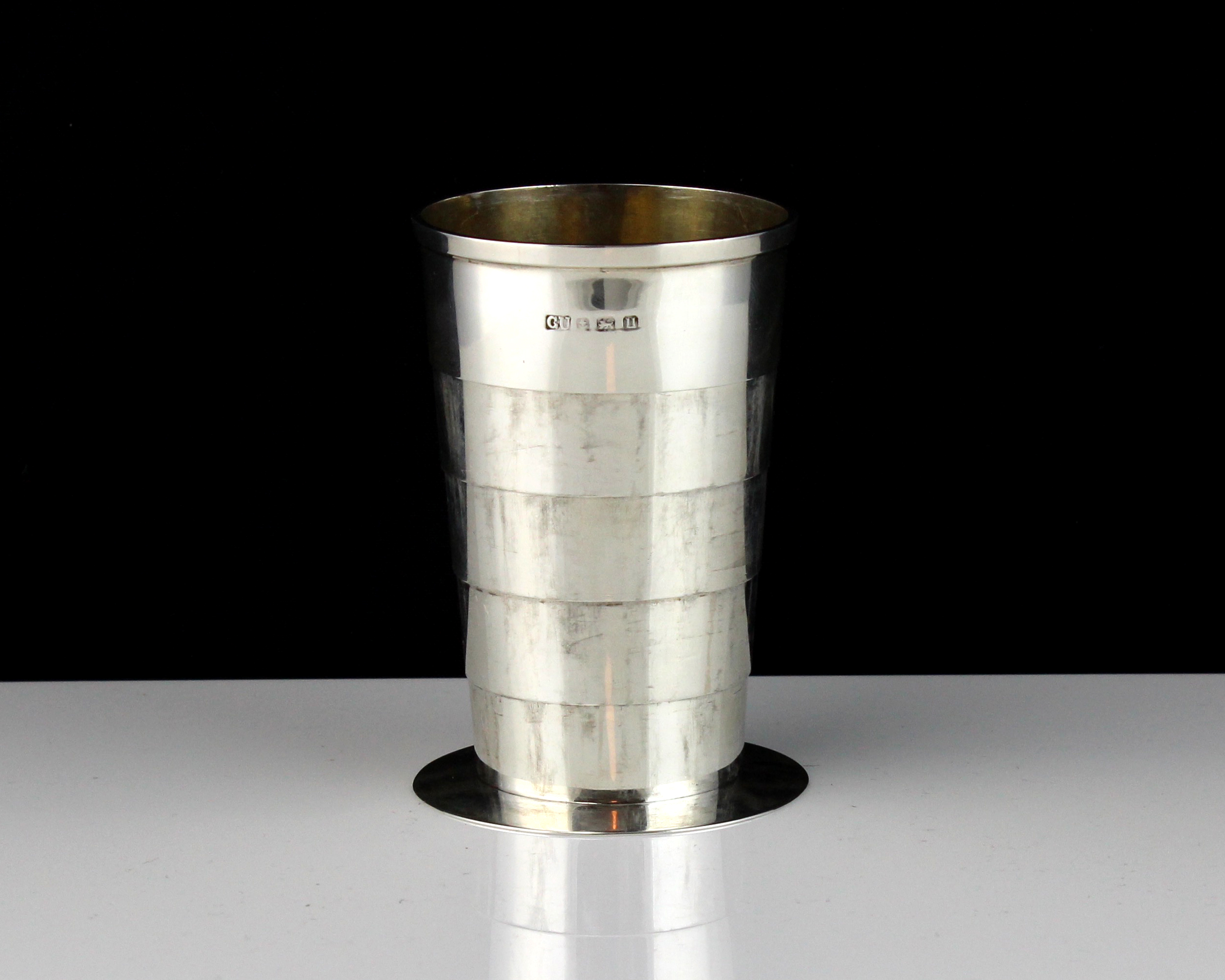 A novelty antique Sterling Silver collapsible cup by George Unite, Birmingham 1939 on a circular
