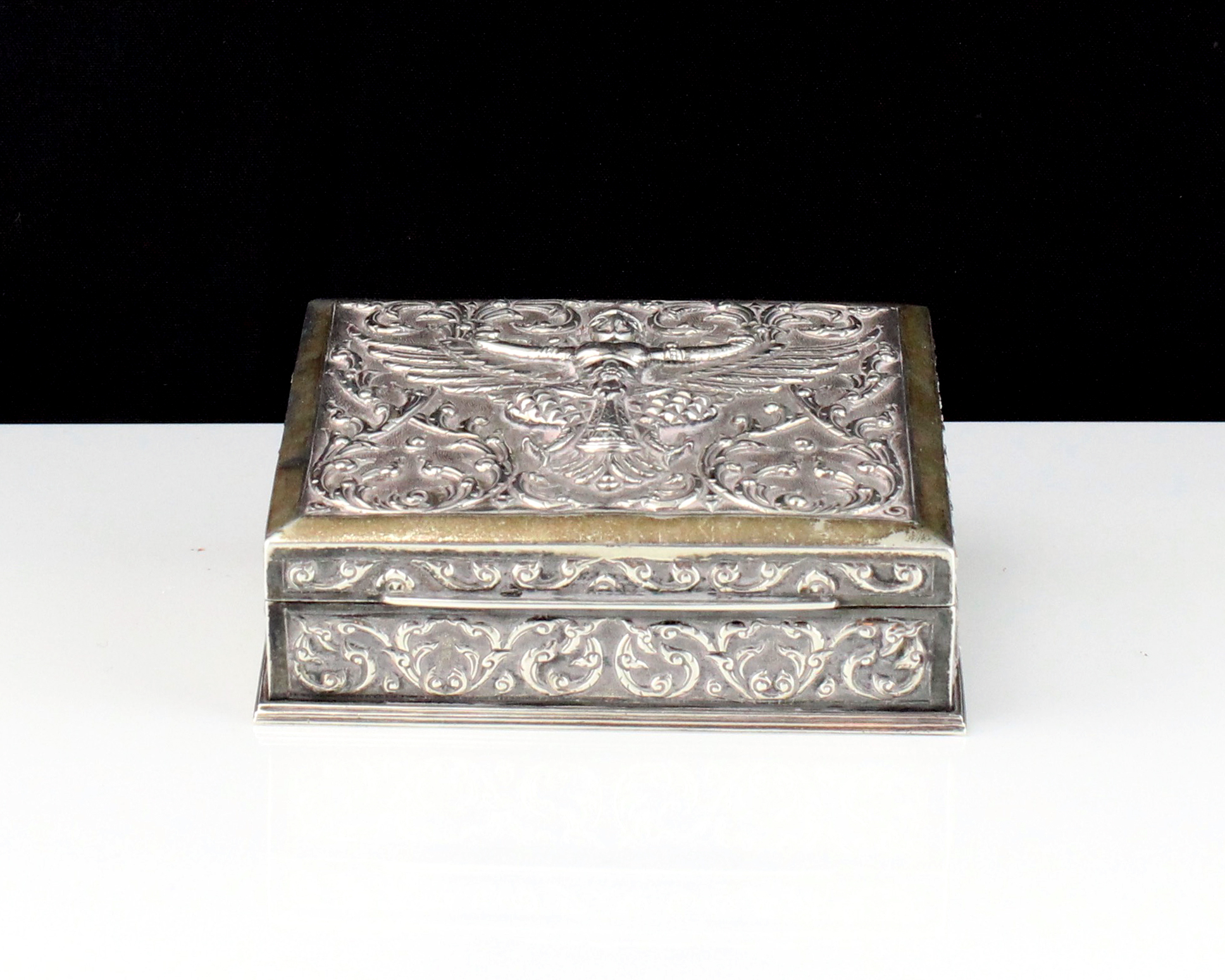 A mid 20th Century Siamese / Thai Sterling Silver cigar box of rectangular form with high relief