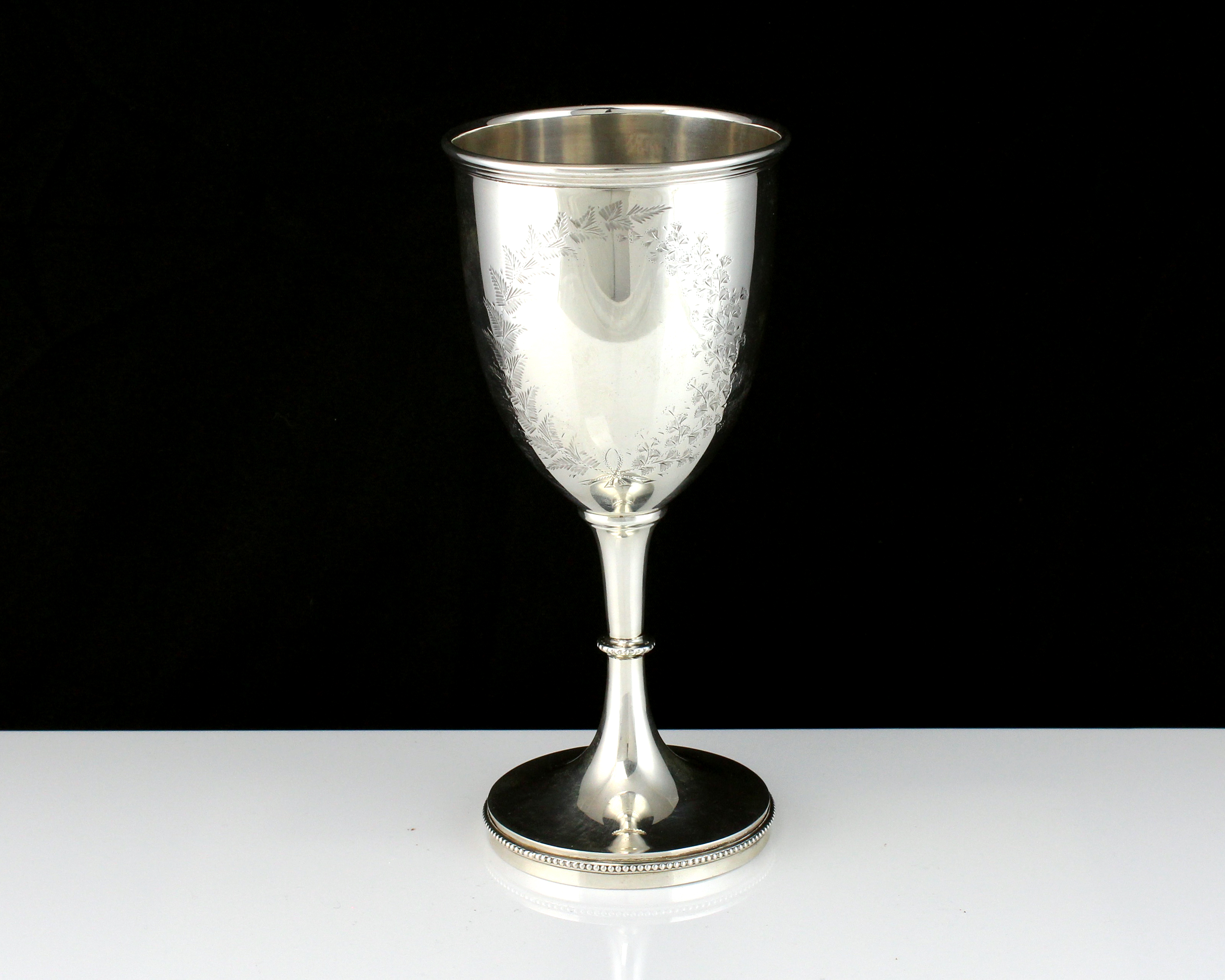 An antique George V Sterling Silver goblet by William Devenport, Birmingham 1910 of typical form,