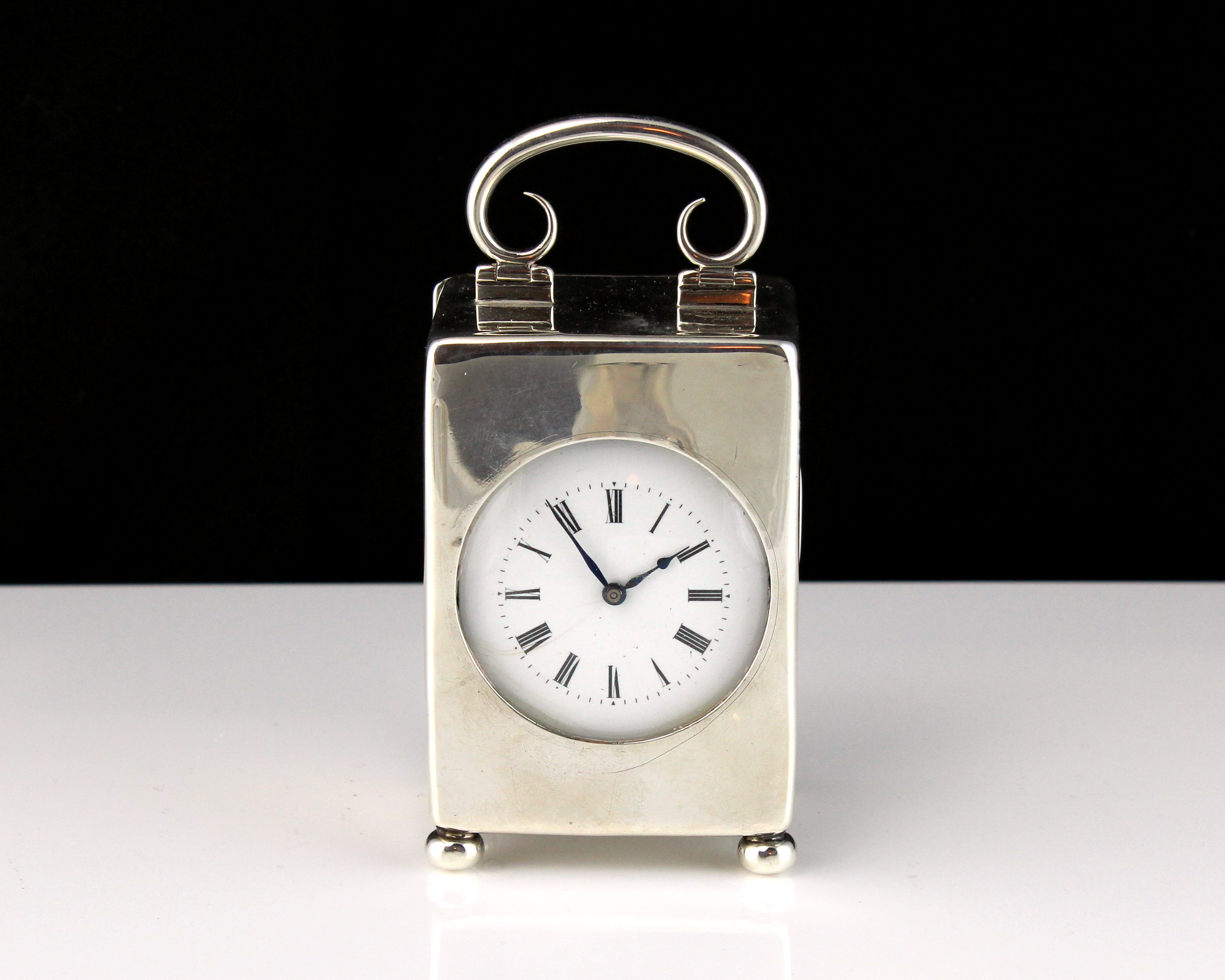 An antique Edwardian Sterling Silver carriage clock by William Comyns, London 1905. Of upright,
