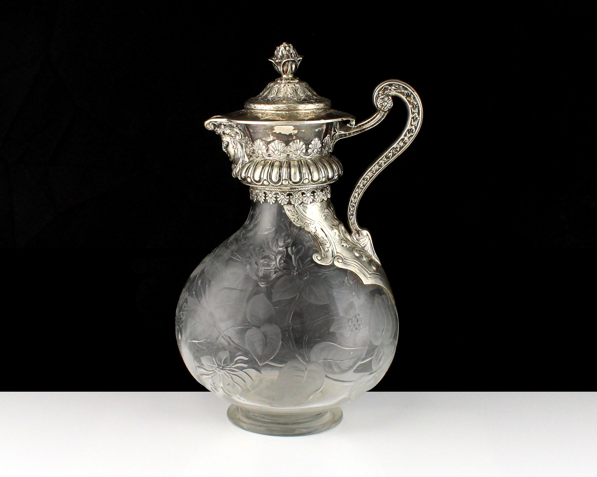 Los 61 - An antique Victorian Sterling Silver mounted claret jug by Mappin & Webb (J N Mappin), London 1886