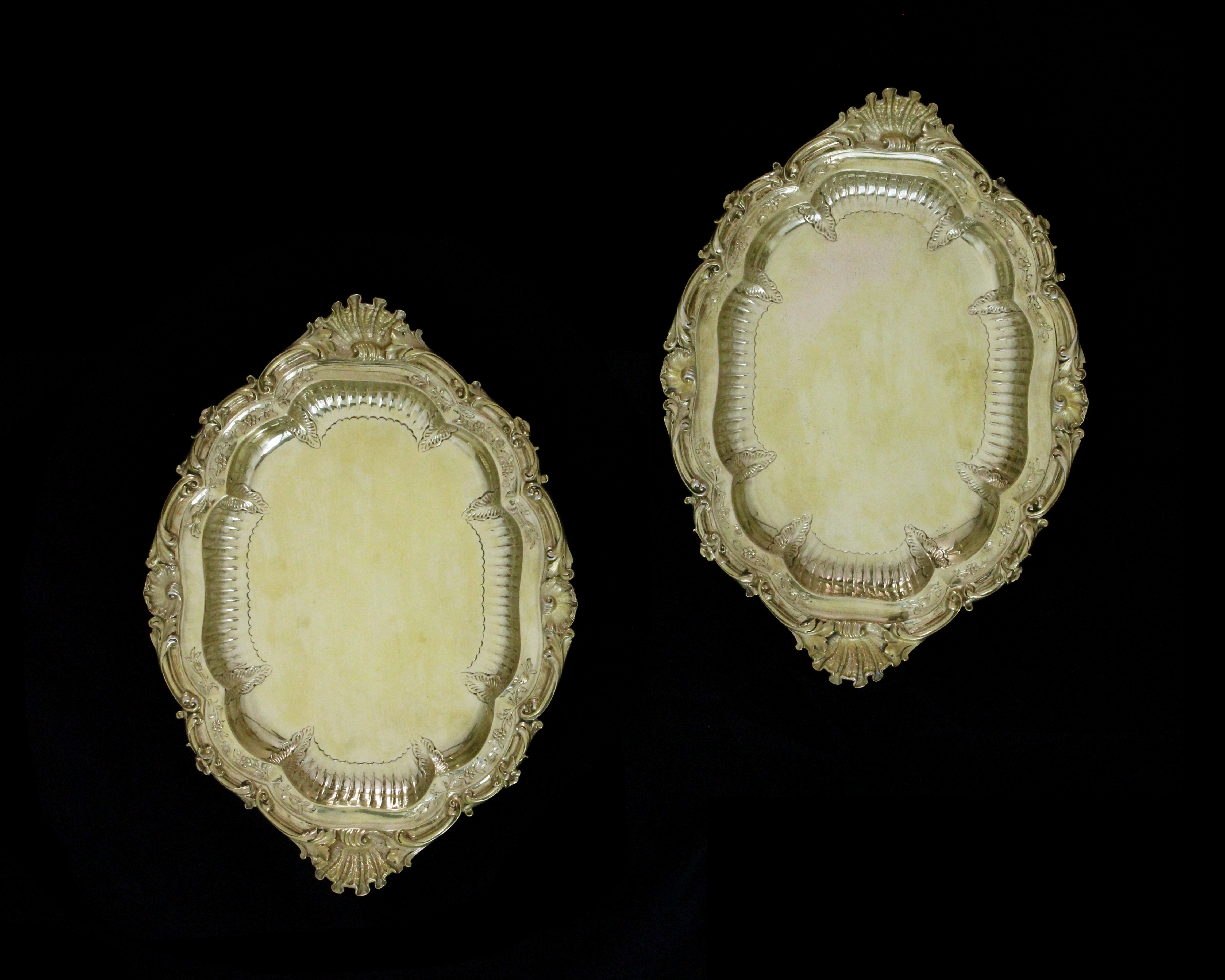 A pair of antique George IV Sterling Silver gilt serving dishes by Paul Storr, London 1827 each of