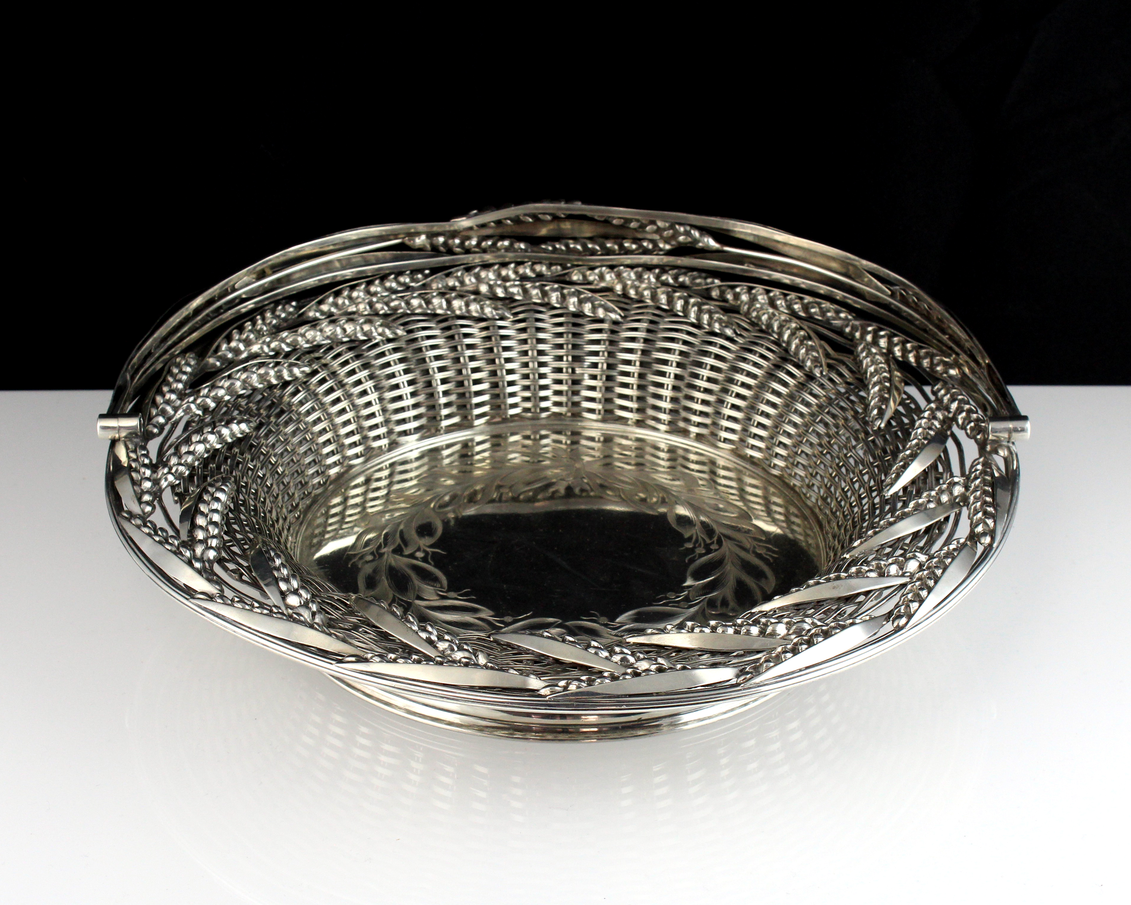 An antique Victorian Sterling Silver swing handled bread / cake basket by Thomas Bradbury & Son,