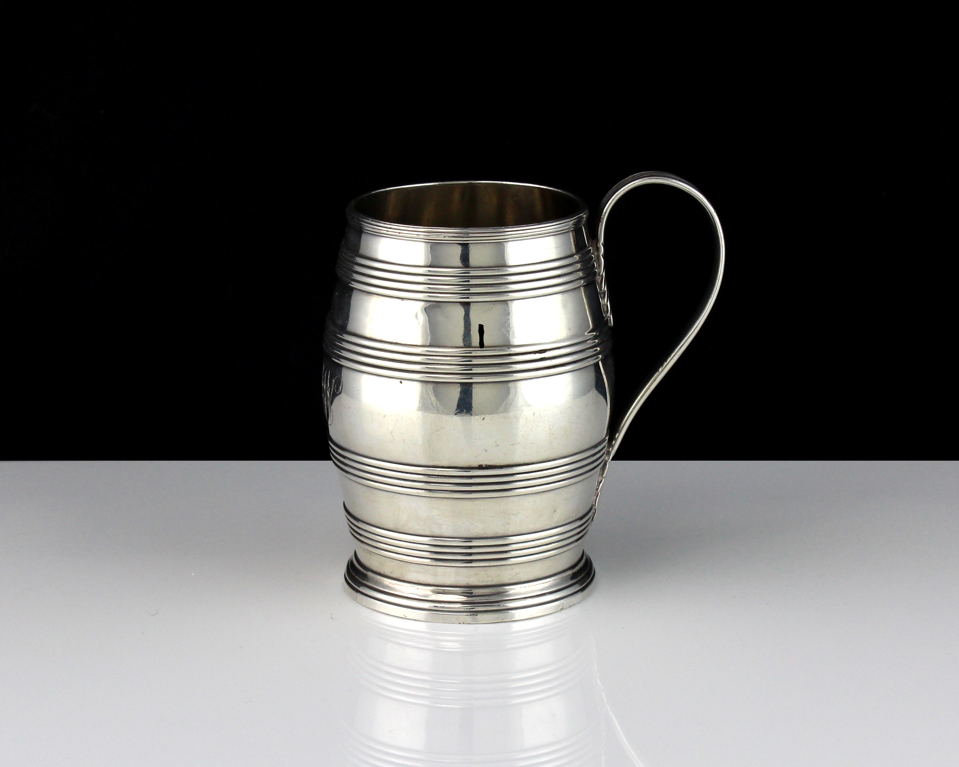 An antique George III Sterling Silver barrel mug by John Robins, London 1783 designed in the form of