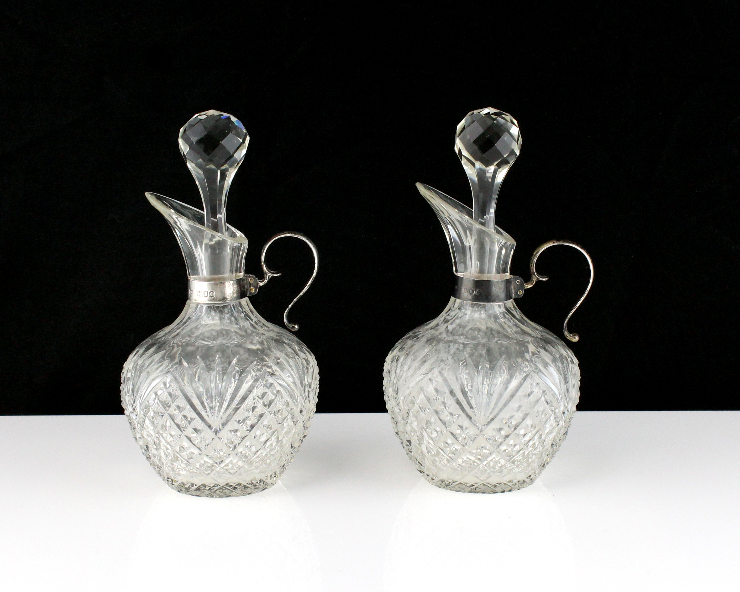 Los 59 - A pair of antique Victorian Sterling Silver mounted oil and vinegar jugs by the Betjemann