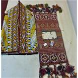 A Turkoman Yomud ceremonial saddle bag, together with a Turkoman silk embroidered kaftan