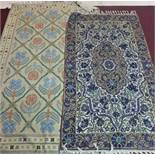 Two Kashmiri embroidered rugs, to include one with central floral medallion and stylised floral