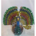 Edgardo Rodriguez (Contemporary artist), a large sculpture of a peacock made from plastic bottles,