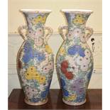 A large pair of Japanese Satsuma baluster vases, moulded in the form of baskets, decorated flowers