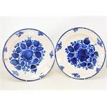 A pair of tin glazed blue and white bowls, decorated flowers, 31.5 cm diameter, two pottery meat