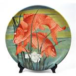A large Minton pottery plate, decorated a pair of carp by H Ryland, signed and dated 1880,